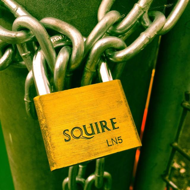 """""""A Squire padlock securing a gate"""" stock image"""