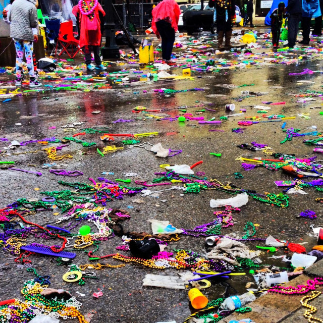 """Mardi Gras beads and throws on St. Charles Avenue after parade in New Orleans"" stock image"