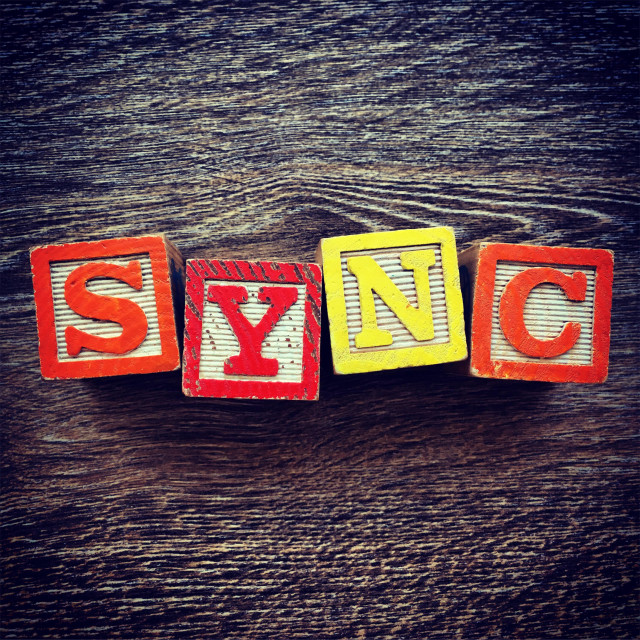 """""""SYNC word written with wood block letter toys"""" stock image"""