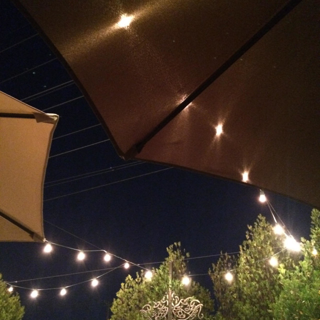 """Patio lights and umbrellas."" stock image"