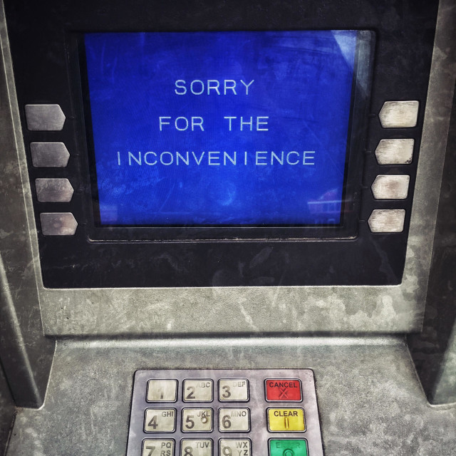 """""SORRY FOR THE INCONVENIENCE"" An ATM displays a message indicating there is no possibility of obtains any cash - is the machine broken? Is there no more Money? Has the ATM been tampered with? ©"" stock image"