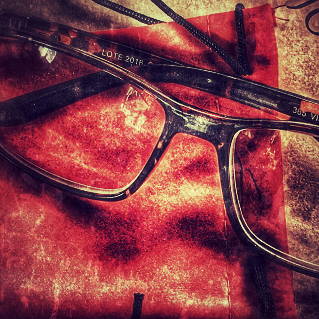 """""""Reading glasses and case on an academic journal"""" stock image"""