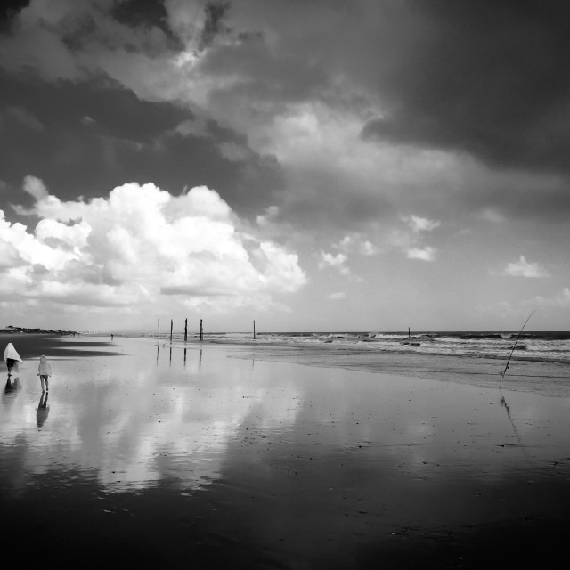"""""""Brother and sister walking on beach"""" stock image"""