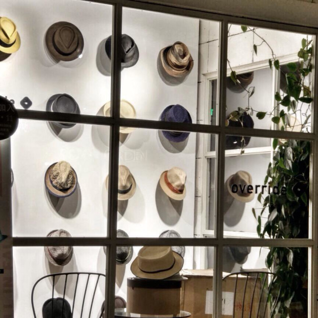 """""""Collection Of Fedoras Hats Hanging Along The Wall Of A Hat Shop"""" stock image"""
