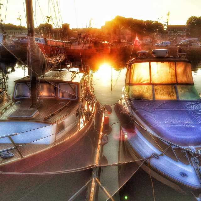 """""""Sail boats in a harbor in morning sun"""" stock image"""