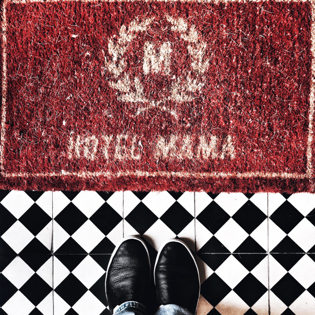 """""""Red doormat with HOTEL MAMA caption"""" stock image"""