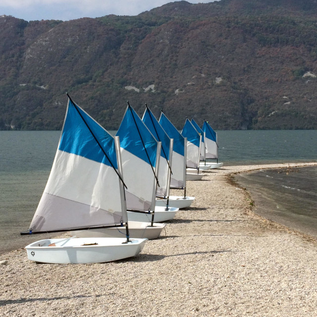 """Little sail boats on banks of lake at Aix Les Bains"" stock image"