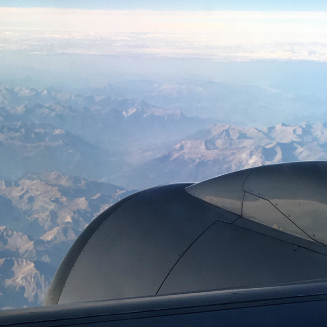 """""""View of Boeing 757 starboard engine from the cabin of an airliner flying over the French Alps"""" stock image"""