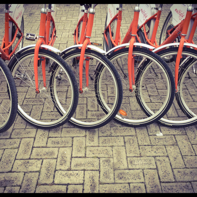 """""""Row of bicycles along Seapoint promenade."""" stock image"""