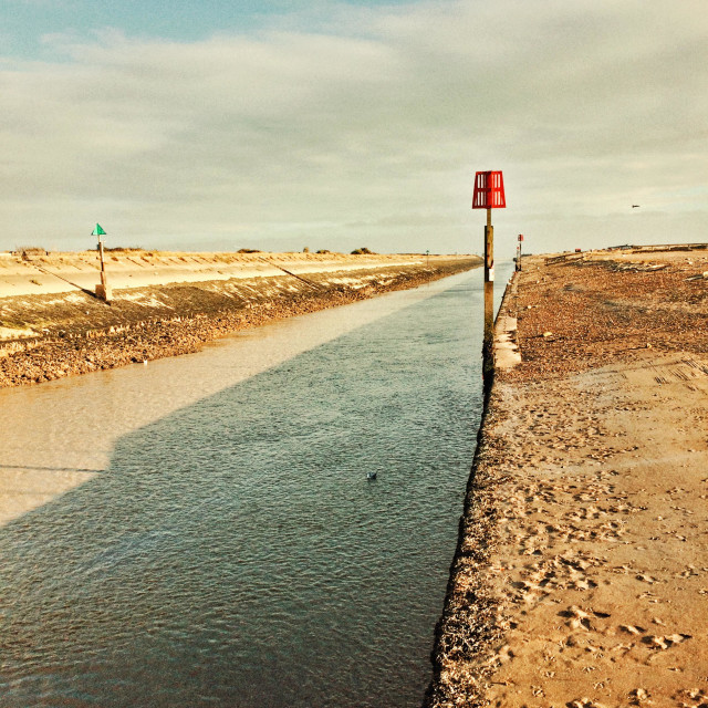 """""""The channel and markers to Rye harbour in Kent England"""" stock image"""