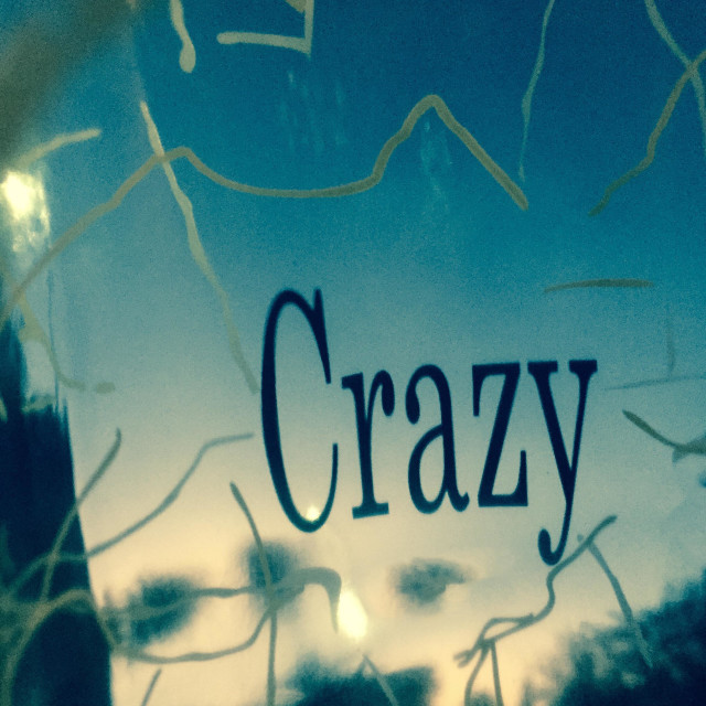 """""""Crazy cracked glass inferring madness, wildness"""" stock image"""