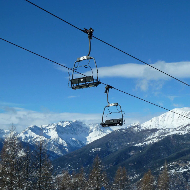 """Chair lifts above Sauze d'Oulx"" stock image"