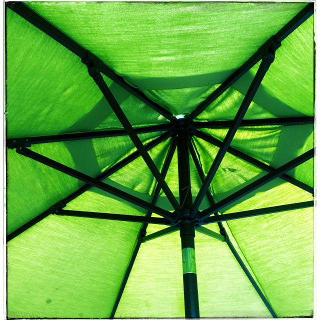 """Under a green umbrella"" stock image"