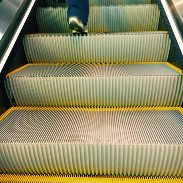 """Walking up broken escalator"" stock image"