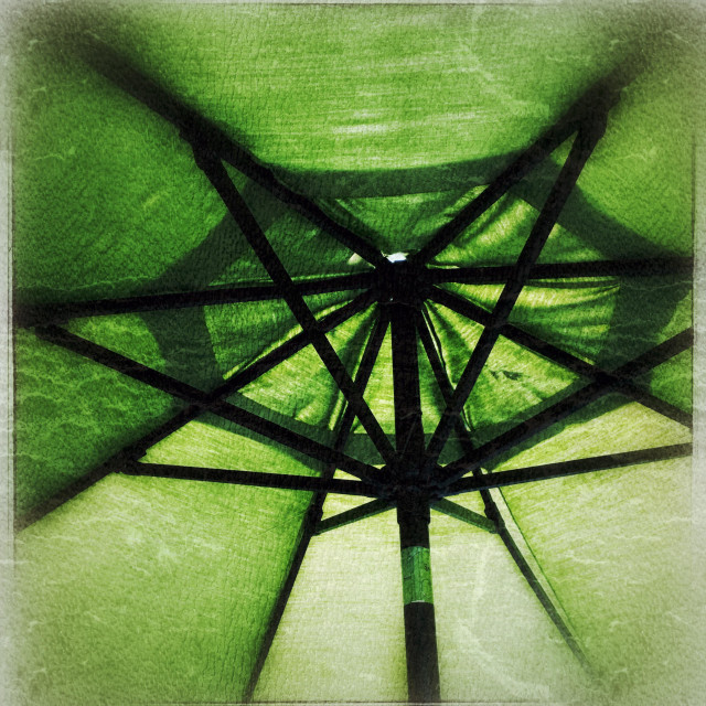 """Under a green umbrella taken with grunge film"" stock image"
