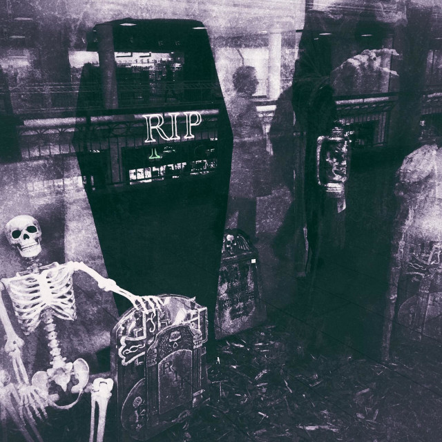 """Hallowe'en skeleton, coffin and ghoul"" stock image"