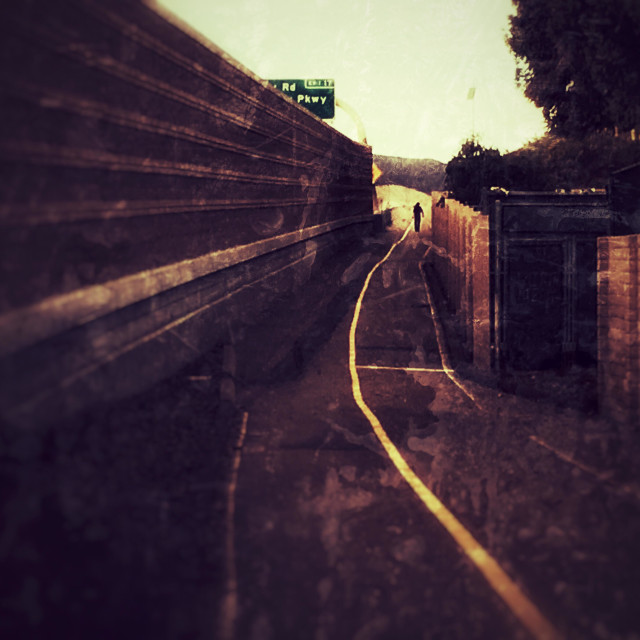 """Man walking along the freeway"" stock image"