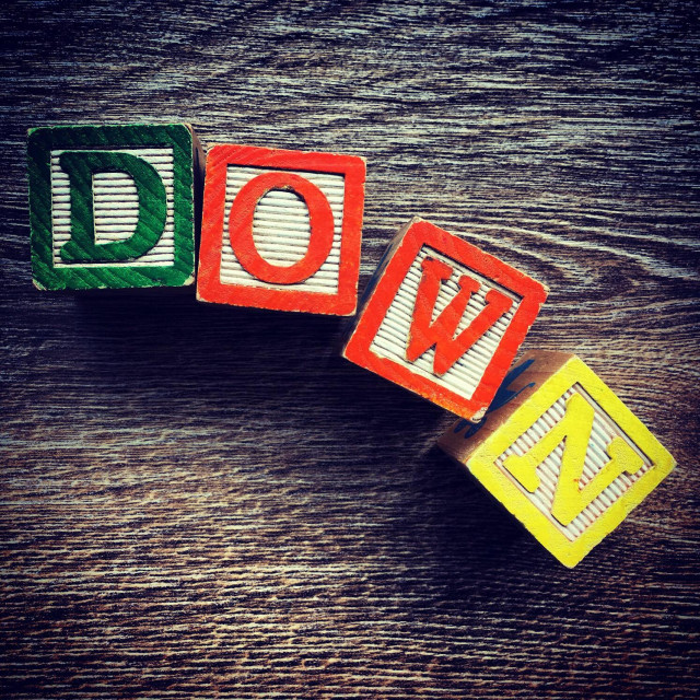 """DOWN word written with alphabet wood block letter toys"" stock image"