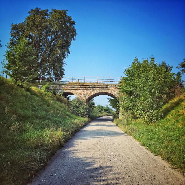 """""""Railway bridge over dirt road near Koscierzyna city, Pomeranian Voivodeship, Poland"""" stock image"""