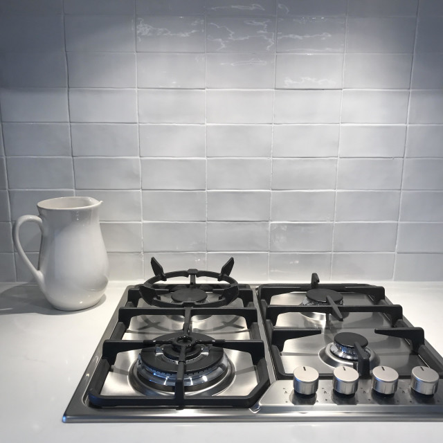 """Kitchen cook top white tiles white jug"" stock image"