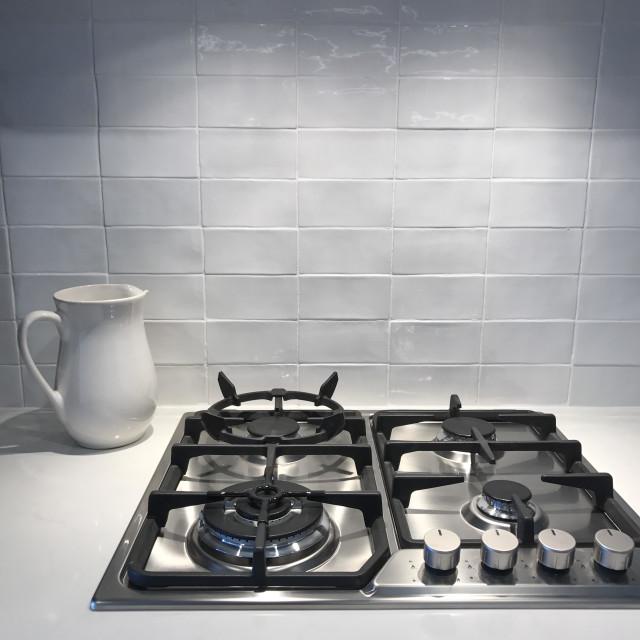 """""""Kitchen cook top white tiles white jug"""" stock image"""