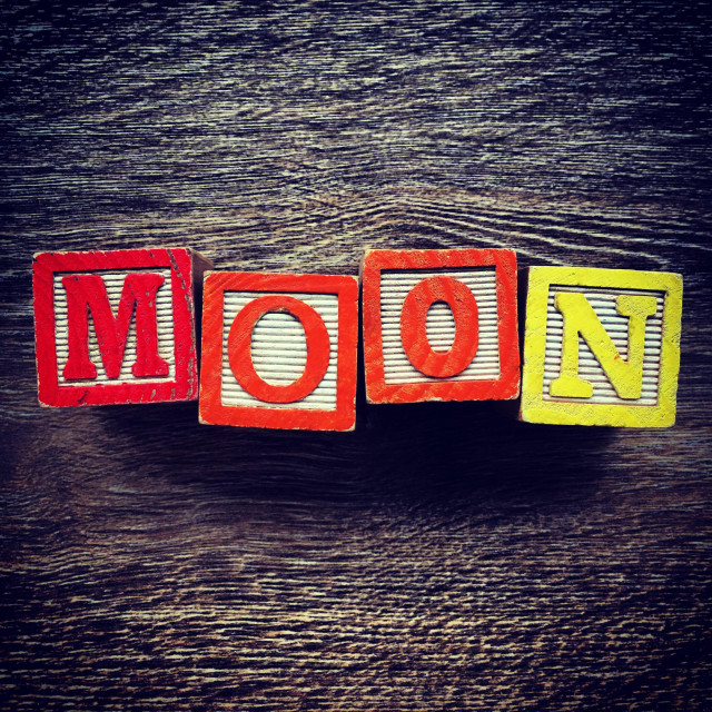 """MOON word written with wood block letter toys"" stock image"