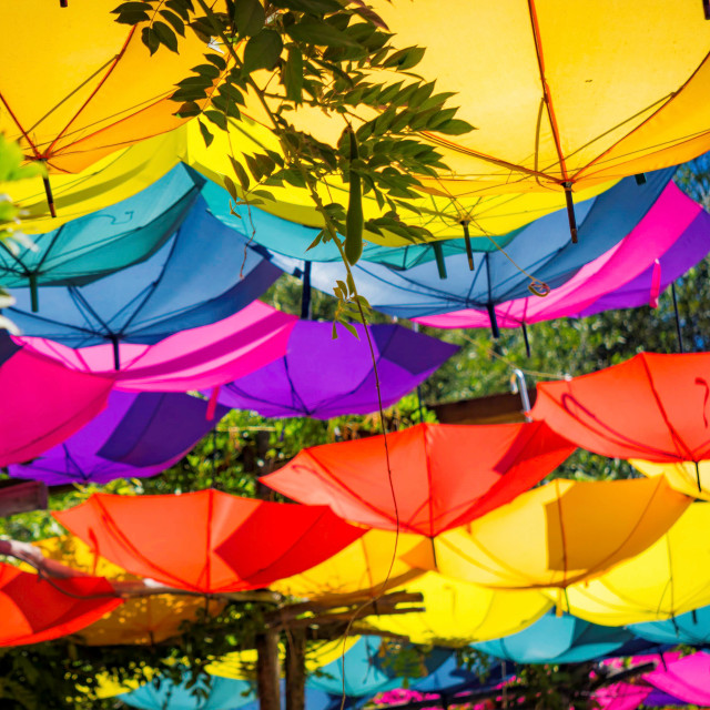 """Upturned brightly colored umbrellas"" stock image"