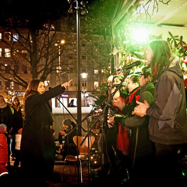 """Christmas Market in Munich Harras at night, gospel choir"" stock image"