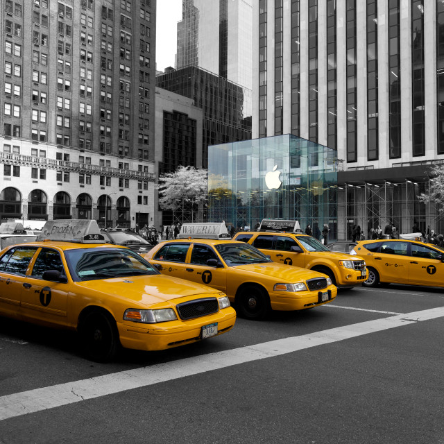 """Yellow cabs and Apple Store, NYC, USA"" stock image"