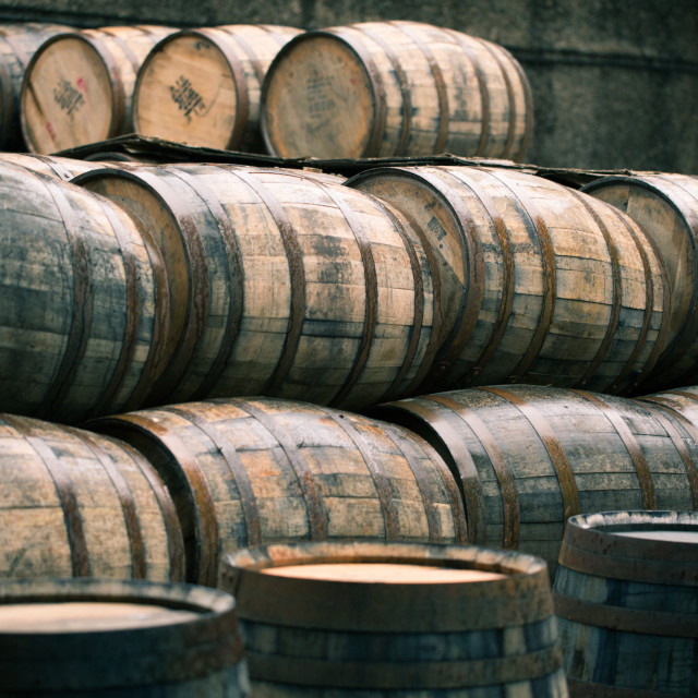 """Whisky barrels full of whiskey in Scottish traditional distillery"" stock image"