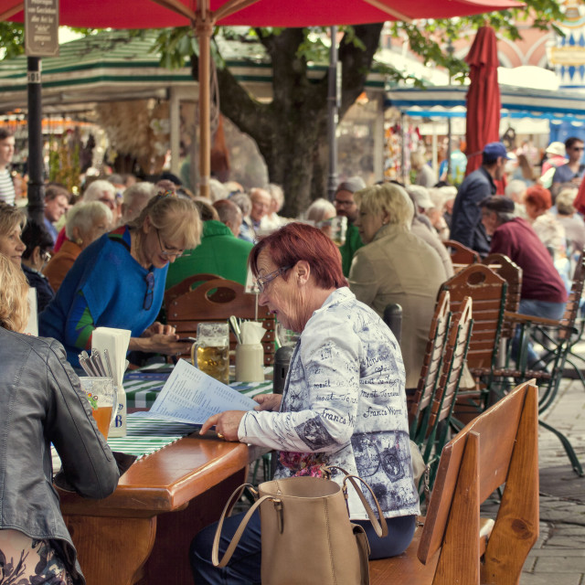 """People seat at beer garden in Viktualienmarkt, gourmet point in Munich center"" stock image"