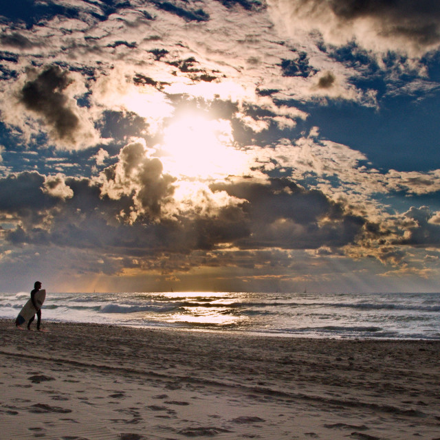 """""""A surfer walking on the beach"""" stock image"""