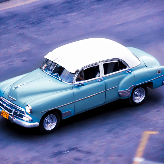 """Classic American car driving through Havana"" stock image"