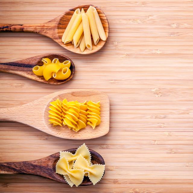 """Italian foods concept and menu design. Various kind of Pasta Elbow Macaroni..."" stock image"