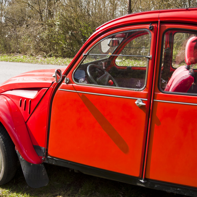 """""""French Citroen 2CV red,lateral view"""" stock image"""
