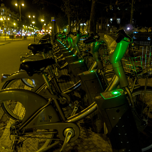 """Paris Bikes by Night"" stock image"