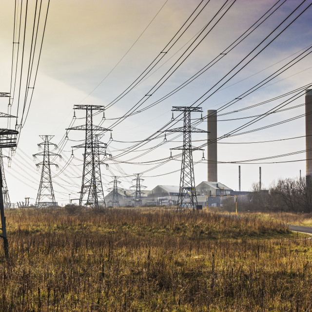 """Pylons, overhead cables and power station"" stock image"