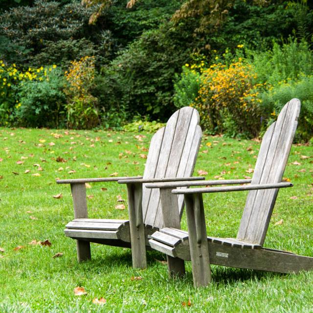 """Adirondack Chairs on Lawn"" stock image"