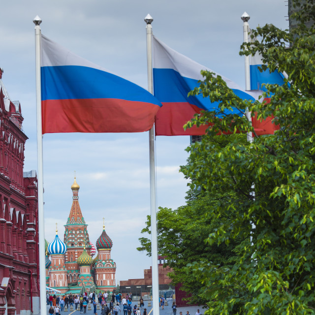 """MOSCOW - JUNE 02, 2016 : Russian flag and St Basils cathedral on Red Square..."" stock image"