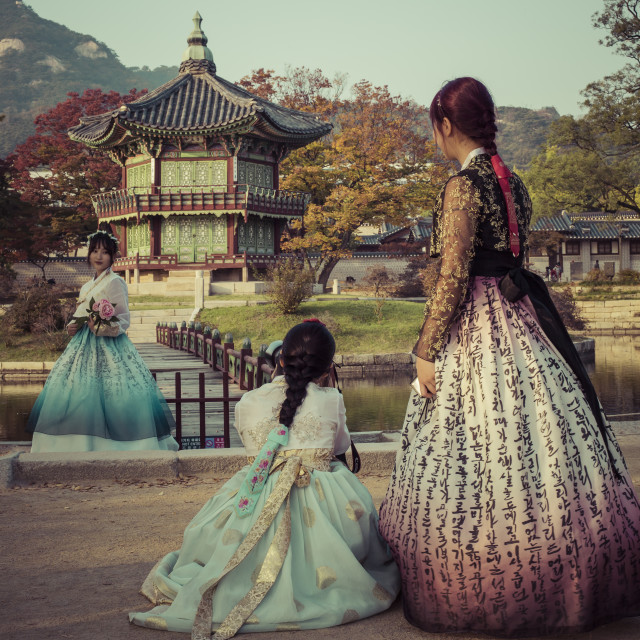 """""""Autumn at Gyeongbokgung Palace in Seoul,Korea.Young girls in traditional dresses"""" stock image"""