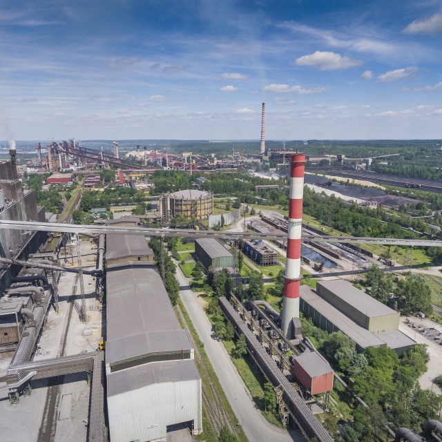 """Steel factory with smokestacks at suny day.Metallurgical plant. View from above."" stock image"