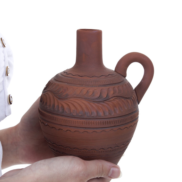 """""""Clay pitcher in female hands"""" stock image"""