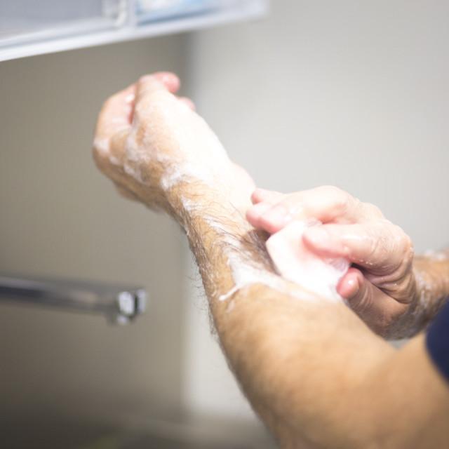 """Surgeon washing hands"" stock image"