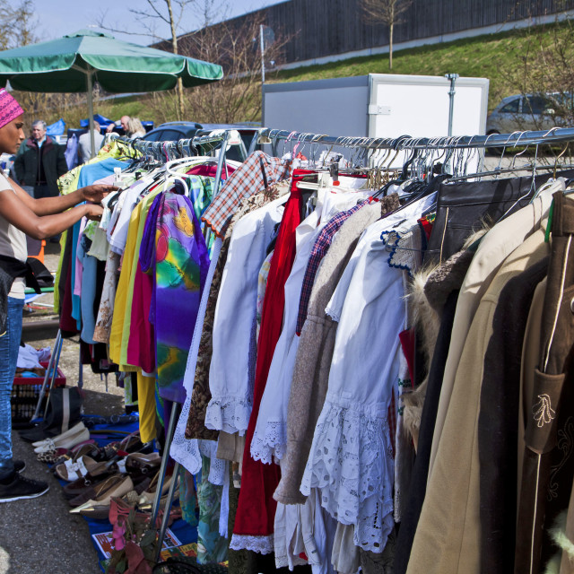 """Eching, Germany - girl looks at open air second hand wardrobe for discount wear"" stock image"