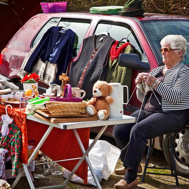 """""""Seller knits at flea market stall waiting for customers"""" stock image"""