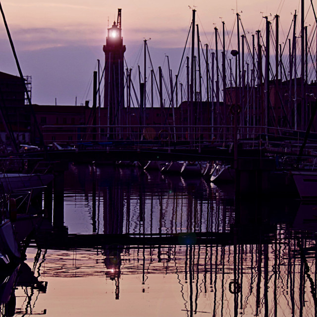 """""""harbor and lighthouse at sunset"""" stock image"""