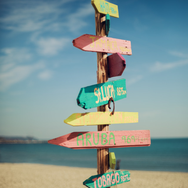 """Wooden handmade signpost on the tropic beach."" stock image"