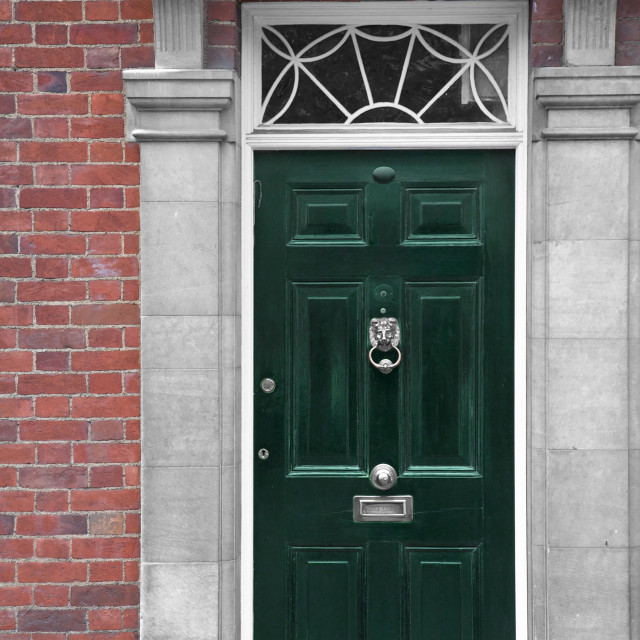 """Grand green wooden door, part of a home, London"" stock image"