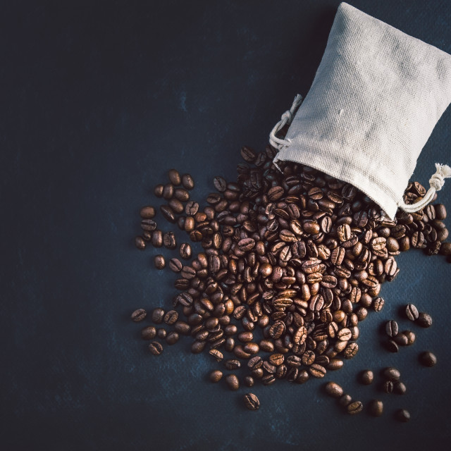 """""""Coffee beans on black and blue background with dramatic light."""" stock image"""