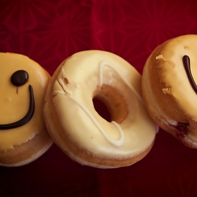 """""""Assorted doughnuts on red tablecloth"""" stock image"""